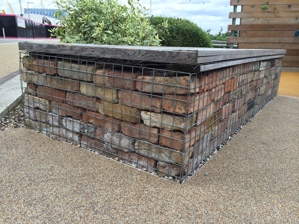 Bricks in cage seat on Thames Path in Greenwich